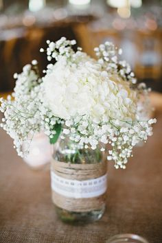 white hydrangea with baby breath - burlap wrapped centerpiece - mason jar
