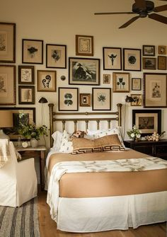 this would be a wonderful guest room in an old farmhouse with old photos of family and friends all done in sepia-tone