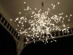 It is an easy DIY light. All you need is an umbrella frame spray painted white with Christmas lights twisted and drapes on each arm. The best option is to chose Christmas lights with a battery operated box as you dont have to put cords through the roof or use extension cords.