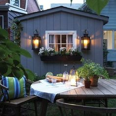 huge outdoor lanterns hung from hooks, window with window box full of flowers--window could even be a fake one on the shed Outdoor Rooms, Outdoor Dining, Outdoor Decor, Dining Area, Outdoor Lighting, Indoor Outdoor, Outdoor Furniture, Porches, Curb Appeal