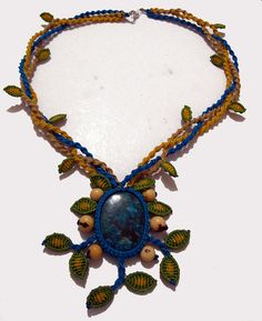 Collar de hojas con piedra Turquesa by Freckles_, via Flickr