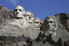 sculptures of the heads of former United States presidents (in order from left to right) George Washington, Thomas Jefferson, Theodore Roosevelt and Abraham Lincoln