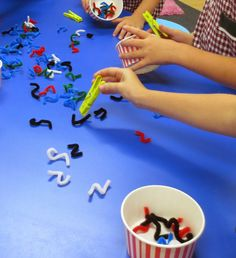 Using pieces of pipe cleaner as worms and clothes pegs as bird beaks is a very easy way to work on developing those little hand muscles and fine motor control.