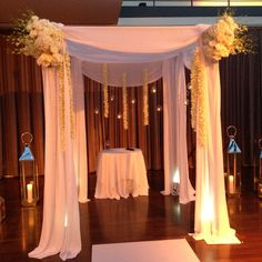 way too white with the flowers but pretty simple modern chuppah