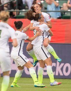 Lauren Holiday hugs Alex Morgan after Morgan's goal against Colombia, June 22, 2015. (Geoff Robins)