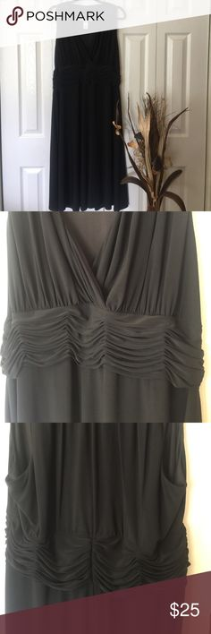 "Draping black dress Gorgeous draping material starting from the shoulders to the crossing V neck, where it then meets a wide band of layered drapes. The band also circles around to the back. Length 49"" Evan Picone Dresses"
