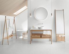 Our Mya collection includes a stool, full-length mirror, towel rack, laundry hamper, and a room divider composed of the same basic elements as the vanity unit. Design Studio Altherr for Burgbad.