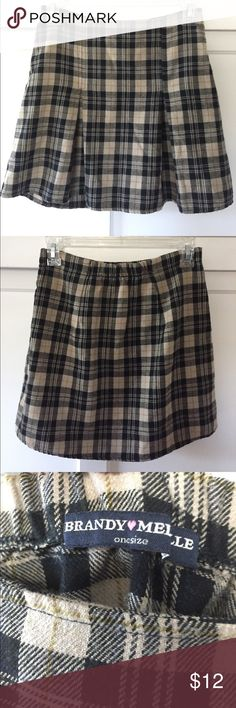 """Brandy Melville plaid mini skirt Brandy Melville brown/black plaid school girl skirt. Used but in great condition. One size. 14"""" waist and 15"""" length. Brandy Melville Skirts Mini"""