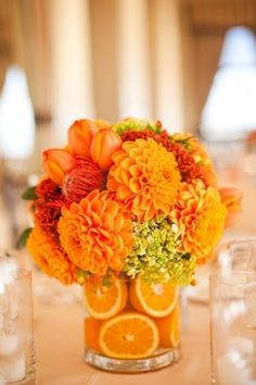 Orange floral and Fruit centerpiece.