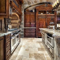 Marble and Granite Chef's Kitchen with Walnut Cabinets
