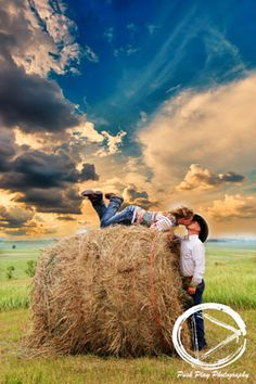 Engagement photography - kissing in bale - cowboy - country couple - love - kisses - farm