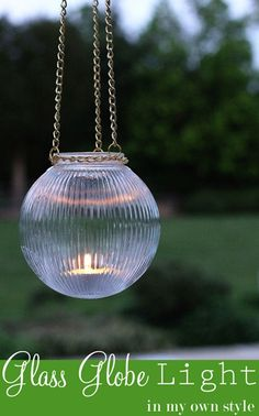 DIY Hanging Candle Lantern made using a glass globe from a ceiling light.