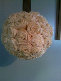 Stuff flowers into styrofoam balls.