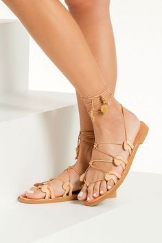 Our signature Danae gladiators are inspired by the ancient Greek wave motif as it also appears in our logo. This pair is made from chemical-free vegetable-tanned leather with adjustable slim ties that can be worn high up or low at your ankles, detailed with gold plated beads and coins. Top quality lace up sandals with anti-slip rubber sole for optimum comfort suitable for everyday wear from day to night. The neutral shade will complement just about everything. Available in 5 colors! Boho Sandals, Greek Sandals, Lace Up Sandals, Flat Sandals, Flats, Fashion Sandals, Women's Sandals, Natural Leather, Leather And Lace