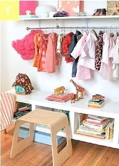 Curtain rod with hooks under a shelf for hanging jackets!
