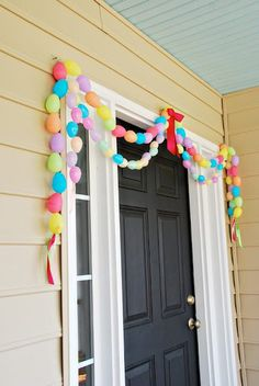 Drill holes in your old plastic eggs and create a garland.