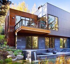modernes Haus mit Stein- und Cortenstahl-Fassadenverkleidung