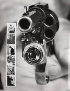 This is BEYOND awesome! It's a revolver camera! It takes a picture when you pull the trigger! Awesome!  :D