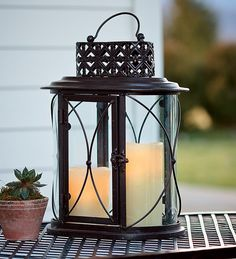 #Plowhearth               #table                    #Glass #Iron #Outdoor #Table #Lantern #Pillar #Candles #Plow #Hearth          Glass And Iron Outdoor Table Lantern And LED Pillar Candles - Plow & Hearth                             http://www.seapai.com/product.aspx?PID=1246481