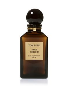 Tom Ford Noir De Noir Eau de Parfum | Dark. Sexy. Indulgent. Encompassing and celebrating the yin and the yang, this rich oriental scent reveals Tom Ford's feminine side. Rich feminine florals and the masculine earthiness of black truffle, vanilla, patchouli, oud wood and tree moss add a warm sensuality to this dark chypre oriental.