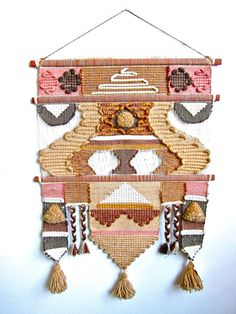 Large 1970s boho kitsch wall hanging in salmon, brown, tan and white.