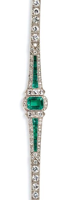 Art Deco Platinum, Emerald, and Diamond Bracelet, bezel-set with an emerald-cut emerald measuring approx. 8.30 x 6.60 x 4.30 mm, and weighing approx. 1.60 cts., flanked by fancy square-cut diamonds and calibre-cut emeralds, framed by single-cut diamond melee, and completed by box-set transitional-cut diamonds, approx. total diamond wt. 5.25 cts., lg. 7 in.