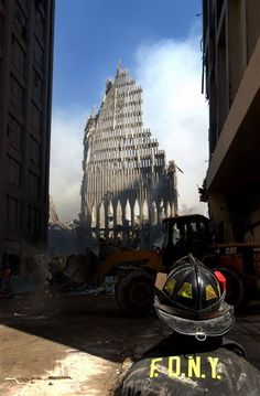 Stock Photo - NYC fireman looks up at what remains of the North Tower of the WTC after its collapse. World Trade Center, New York City, 2 days after September 2001 World Trade Center, Trade Centre, Belize City, We Will Never Forget, Lest We Forget, Day Of Infamy, September 11, New York City, Instagram