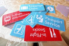 Airport signs for airplane party by Victoria Chow. Print on regular paper and stick on foamboard