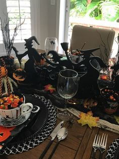 Happy Happy Halloween tablescape. Love the witch silhouette centerpiece.