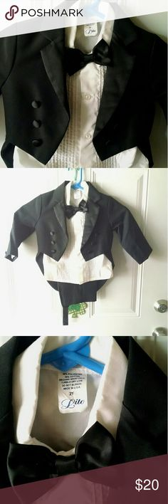 Toddler Tuxedo Perfect Condition! Comes with: Shirt, pants, jacket, bow tie and cumber bun.  Not selling any pieces separately. Matching Sets