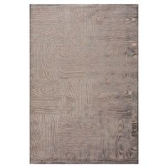 Stylishly anchor your living room or master suite with this eye-catching art silk and chenille rug, showcasing a woodgrain-inspired motif.  ...