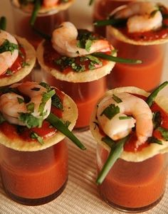 One-Bite Shrimp Cocktails with Zesty Vegetable Juice Shot. I like this idea with a bloody mary shot for a brunch party.