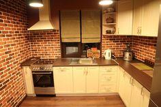 small kitchen. all walls brick