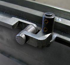 Custom window hardware in blackened steel  by Face Design + Fabrication