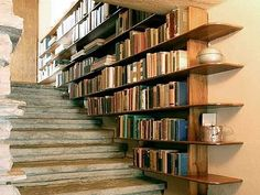 Staircase bookshelf - DIY Bookshelves : 18 Creative Ideas and Designs. Yes, I have seen a few DIY versions of the staircase bookshelf, wonderful design idea. Staircase Bookshelf, Bookshelf Ideas, Creative Bookshelves, Stair Shelves, Book Stairs, Bookshelf Decorating, Bookshelf Design, Cheap Bookshelves, Decorating Ideas