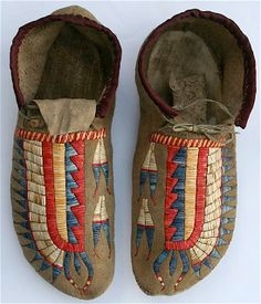 Contemporary Makers: Norbert Kohlruss Quilled Moccasins. Late 1800s Great Plains moccasins...elk sinew quilled on braintanned buckskin...dyed and natural porcupine quills...hand scraped rawhide soles, antique cloth binding on cuffs.