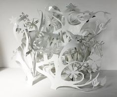 made by Tord Boontje studio http://crafthunters.com/en/things/paper-cut-lights-Tord-Boontje#