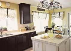 Blonde by Sherwin Williams  Kitchen Cabinets: Sherwin Williams Black Latex Acrylic Paint  Island: Sherwin Williams Navajo White