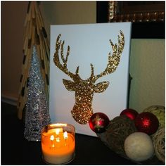 DIY Christmas Decor - Glitter Deer- saw something like this on Nate Berkus show, they spray painted the outline of the Deer it was so cute
