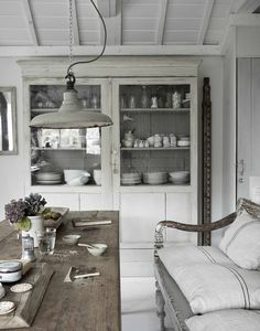 Weathered Wood Table, unique overhead light and fresh white linens and paint all come together in this beautiful room. #DIYDriftwood