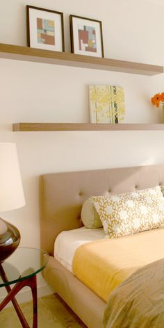 I like the clean lines of the shelves, headboard and bedside tables here. Guest room?