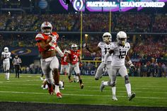 Running back Ezekiel Elliott #15 of the Ohio State Buckeyes scores a 33-yard touchdown in the first quarter against the Oregon Ducks during the College Football Playoff National Championship Game at AT&T Stadium on January 12, 2015 in Arlington, Texas. (Jan. 11, 2015 - Source: Tom Pennington/Getty Images North America)