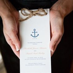 Pattern it after the wedding invitation to keep a consistent theme.  Here, Nautical Ceremony Programs