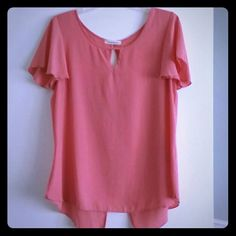 Coral Top with Bow Short sleeve top with front keyhole. Bow in back. Slit back. Never worn.  - Size: XL  - Color: Coral - 100% polyester - Dry clean or hand wash cold DreamofPassion Tops