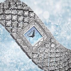 Scintillating Snowfall  A striking diamond jewellery watch, featuring 278 diamonds, inspired by the delicate appearance of snow as it falls from the sky.  The strong lines and sculptural forms of individual snowflakes are beautifully represented within an intricate lattice design. #GraffDiamonds #GraffSnowFall #SnowFall #DiamondWatch