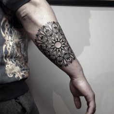 Blackwork/ornamental style mandala tattoo on the right forearm....