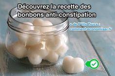 Bonbons blancs anti-constipation dans un bocal en verre