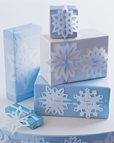 Gift Wrapping Ideas   Several ideas but this one is my favorite....go figure! even my kids can make these snowflakes, maybe I should get them to make them all, and I can just tack them on the gift!