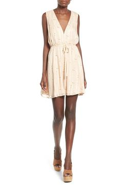 Free shipping and returns on Wayf Floral Print V-Neck Shift Dress at Nordstrom.com. Delicate floral sprigs float on the subtly striped surface of this sweetly retro-chic frock made modern with a plunging V-neckline.