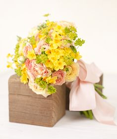"""Beautiful bouquet, but I'd ditch the pink and replace it with more yellow or with cream.  """"Yellow Narcissus: Similar in looks to a daffodil, the tiny spring bulb fits right in with the peppy mix of ranunculus and blupleurum."""""""